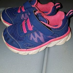 Pink and blue tennis shoes